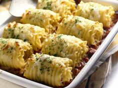 SUPER easy chicken & cheese lasagna roll-ups.