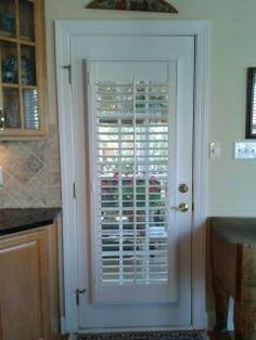 A kitchen door with a louvered plantation shutter is a great option instead of a blind. It is secured to the door with a decorative 4 sided frame. It will not flap open or jangle against the door as people come and go like a blind will. House Design, Windows And Doors, New Homes, Blinds For Windows, Garage Windows, Louver Windows, Blinds, Window Shutter Blinds, Shutters