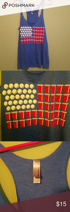 Flag beer pong tank Blue tank with American flag formed by ping pong balls and red solo cups! Very light and loose. Great for summer, 4th of July! I wore this once. There is a very light color shift on the blue where the top goes into the body of the shirt. It is virtually unnoticeable and it came this way, but I wanted to point it out because I did see it upon inspection. Tops Tank Tops
