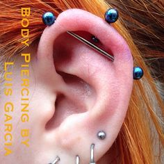 Industrial piercing by Luis Garcia of NoKaOi Tiki Tattoo and Piercing. Jewelry by Anatometal.