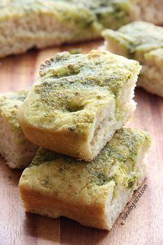 Homemade focaccia bread topped off with a flavorful basil-pesto sauce. Recipe from @Rachel {Baked by Rachel}