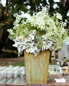 A large centerpiece of Queen Anne's lace, dusty miller, and succulents