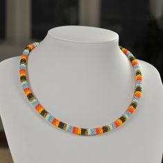 Unique handmade miscellaneous bead necklace made of colorful beads and white thread.