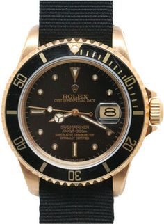 1STDIBS.COM Jewelry & Watches - Rolex - ROLEX Gold Submarine. Black and gold.