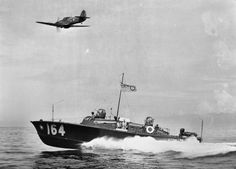 with RAF Hurricane off Colombo 1943 Royal Air Force High Speed Launch HSL 164 of No. 203 Air Sea Rescue Unit heads out from Colombo, Ceylon, into the Indian Ocean, guided by a Hawker Hurricane search aircraft of No. Date circa 1943 Pt Boat, Merchant Navy, Fast Boats, Royal Marines, War Photography, Battle Of Britain, Military Photos, Ww2 Aircraft, United States Navy