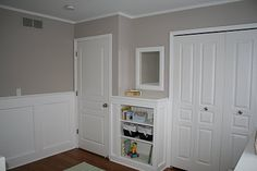 True White for the wainscoting. Above it, we used a color called Sierra Madre from Behr paints