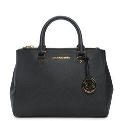 This stunning must-have handbag from coveted brand Michael Kors features gold metal accents, quality leather and attention to detail for a perfectly polished look! #excelyourself with Excel Clothing!