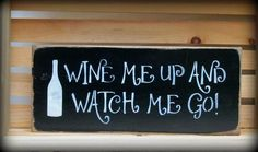 """This wooden funny bathroom sign is made from pine, and measures Approx 5.5""""H x 13""""W. It reads """"Wine Me Up And Watch Me Go"""". The front is painted Black then distressed, the back is stained . Router spo"""