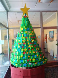 Christmas tree built with toilet roll tubes Unusual Christmas Trees, Alternative Christmas Tree, Diy Christmas Tree, Christmas Makes, Christmas Crafts For Kids, Xmas Crafts, Xmas Tree, Winter Christmas, Christmas Time