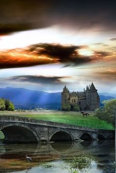 ...dark clouds over the castle, as the sun peeks through the horizon...