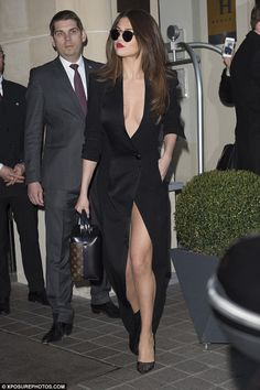Stunning: Selena Gomez looked absolutely sensational in a very low-cut gown with a VERY daring side split as she ventured out during Paris Fashion Week on Tuesday