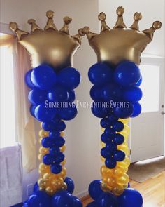 Gold and royal blue crown balloon columns