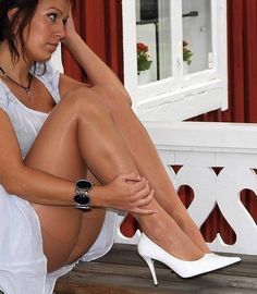 Nude pantyhose with classic white high heels pumps