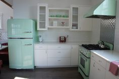 Retro Beach House Kitchen. love the mint My mom had a refrigerator just like this one!  The color was called turquoise then.