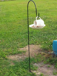 my re-purposed items as a bird feeder. I set a Shepperd Hook in the yard to hang it from:)