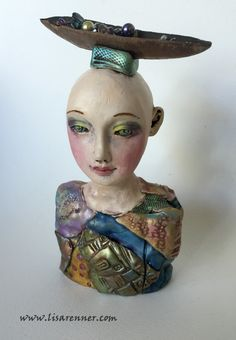 Polymer clay art doll bust by Lisa Renner. Hand painted eyes.