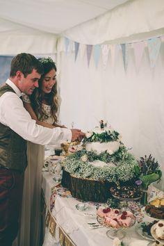 A wedding in North Yorkshire with the bride in a blush pink vintage gown and the groom in tweed. Marquee wedding with paper flower arch and wild flowers. | Rock My Wedding