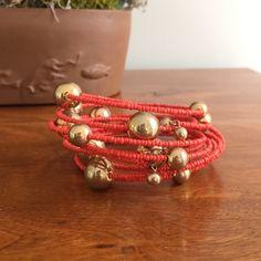 Francesca's Collections Orange & Gold Bracelet Francesca's Collections Orange Bead & Gold Ball Bracelet. Never worn! Cords around arm. Stunning piece for spring & summer!  Francesca's Collections Jewelry Bracelets