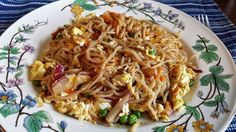 Five Minute Lo-Mein For One (S) * 1 tsp butter * 1 pack Not-Naughty Noodles * 1-2 green onions, chopped * 1 radish * 1 Tbsp carrot shreds (just use your peeler to get a little bit) * 2 Tbsp frozen peas * soy sauce (or liquid aminos, or tamari) * garlic powder * crushed red pepper flakes * ginger powder * 2 eggs * nutritional yeast * sesame oil: