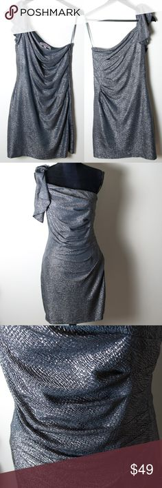 Hailey Logan Adrianna Papell Silver Dress Large Great preloved condition dress from Hailey Logan by Adrianna Papell. No noticeable holes, stains or rips. Flattering one-shoulder sleeved, silver shimmer dress. The embellished ruffle with side ruching completes this dress. One shoulder sleeve, ruched waist, asymmetrical neckline, fully lined, side zipper, ruffled sleeve, shimmering draped. Hailey Logan Dresses Midi