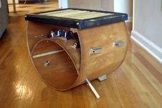 """the donny"" - used drum sticks and broken bass drum accent table/coffee table. www.timsway.net"
