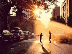 By James Chororos, a Brooklyn-based photographer and architect. Chororos uses his photos to document poetic moments that might have passed by unnoticed. Case in point: a stirring photo of city kids playing in a fire hydrant, lit by the orange setting sun.