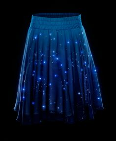 Twinkling Stars LED Skirt - We guarantee this skirt will put a twinkle in your step. Equipped with over 250 tiny LEDs, this midi-length skirt flatters many body types (and with an elastic waist fits them, too).