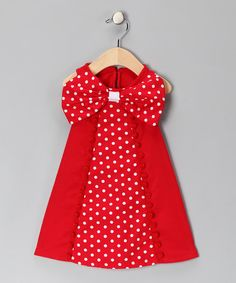 A big colorful bow adorns the top of this comfy cotton dress, making this the perfect snug piece to wrap little darling gifts within.100% cottonMachine wash; tumble dryMade in the USA