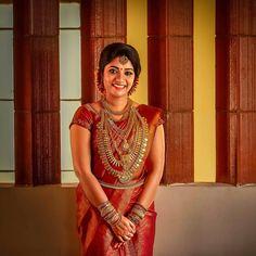 Image may contain: 1 person, standing Kerala Hindu Bride, South Indian Bride Saree, Kerala Wedding Saree, Saree Wedding, Indian Bridal, Kerala Saree Blouse Designs, Bridal Blouse Designs, Bride Reception Dresses, Bridal Silk Saree