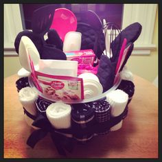 a bridal shower gift basket made with a cake taker dish towels kitchen utensils