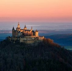 Hohenzollern Castle, Germany. Hohenzollern Castle is the ancestral seat of the imperial House of Hohenzollern. The third of three castles on the site, it is located atop Berg Hohenzollern, a 234 m (768 ft) bluff rising above the towns of Hechingen and Bisingen in the foothills of the Swabian Alps of central Baden-Württemberg, Germany. Photo by jacqueline_fellmann (Instagram)
