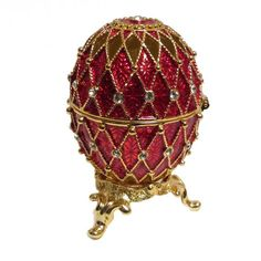 This Faberge style egg is made in old traditions of by Russian company AKM. The egg is made of brass, gilded, enameled with several layers of multicolored enamel and it is also nicely decorated with Austrian crystals.