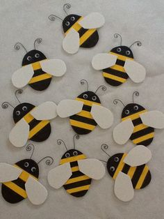 Bumble bee shower: Made these bees from yellow and white craft foam. Stripes were drawn on with a sharpie pen. Google eyes and craft wire finish them. All supplies found at Michaels. I placed these on the tables.