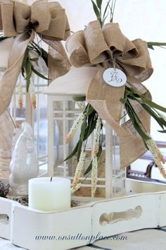 Use lanterns, burlap and bows to make a centerpiece that can easily go from summer into fall. How-to included. Use lanterns, burlap and bows to make a centerpiece that can easily go from summer into fall. How-to included. Burlap Projects, Burlap Crafts, Diy And Crafts, Craft Projects, Projects To Try, Christmas Flowers, Christmas Decorations, Table Decorations, Natural Christmas