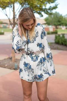 Give me the blue romper. This best selling print is now available in a super trendy romper version just in time for Fall! We love it worn with black lace up hee
