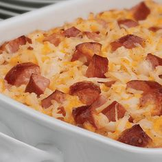 Cheesy Potatoes with Smoked Sausage - This cheesy, creamy casserole is brimming  with hash brown potatoes, cheddar cheese, onions, and served with sour cream on the side.