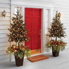 The Estate Door Prelit Christmas Tree Planter - Hammacher Schlemmer