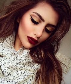 Makeup for fall look. Gold eye sjadow, wing tip, deep dark burgandy lip. Love the scarf and hair too!