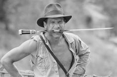 Harrison Ford goofing around on the set of Indiana Jones and the Temple of Doom.