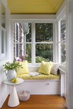 I love the idea of window seats but they aren't often all that comfortable. I think they need to be a bit wider and long enough to stretch legs out on...