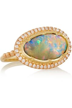 Brooke Gregson Every precious stone used in Brooke Gregson's designs is hand-picked by the designer herself. This 18-karat rose gold ring is set with an oval 5.90-carat boulder opal that has been buffed and polished to bring out its light-refracting, iridescent colors. It has a delicate halo of 0.44-carats of white pavé diamonds and looks best worn solo. 4645