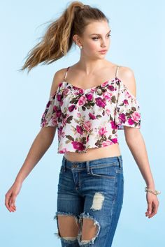Online Exclusive A blooming chiffon crop top, featuring a bold floral print and cold shoulders. V-neck. Spaghetti straps. Short sleeves. Finished short hem. Semi-sheer. Looks amazing with frayed cutoffs and strappy sandals. $17.50