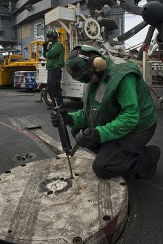 GULF OF OMAN (Aug. 28, 2013) – Aviation Boatswain's Mate (Equipment) 3rd Class David Diedrichs applies grease onto an arresting gear bearing with a grease gun on the flight deck of the aircraft carrier USS Nimitz (CVN 68). Nimitz Strike Group is deployed to the U.S. 5th Fleet area of responsibility conducting maritime security operations, theater security cooperation efforts and support missions for Operation Enduring Freedom. (U.S. Navy photo by Mass Communication Specialist 3rd Class Raul… Us Navy Aircraft, Navy Aircraft Carrier, Military Aircraft, Naval Station Norfolk, Battle Fleet, Uss Enterprise Cvn 65, Gear Bear, Navy Carriers, Uss Nimitz