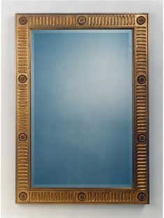 The elegant flutted rectangle mirror was inspired by a handsome neo-classic frame in Paris. The rosette at the corners and the centers of the frame give decorative interest. The finish is in antique gold leaf with a beveled mirror.