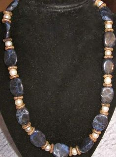 Solidite necklace with gold spacers  20.00$