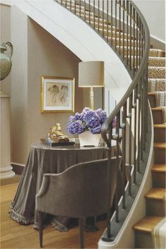 Skirted table tucks in nicely with the curving stairs.