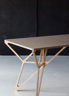 A collection of plywood furniture designed in 2012, which includes a workdesk, a coffee table, a side table and movable container. via be...