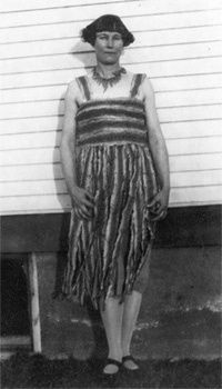 Rattlesnake Kate got her name from a day when she had to fight off 140 rattlesnakes to save herself and her 3-year old son when they attempted to retrieve wounded ducks from a pond.  It took  2 hours to fight off enough snakes to get back on her horse to ride to her home to Greeley, Colorado. She made this dress from rattlesnake skins she cured herself.