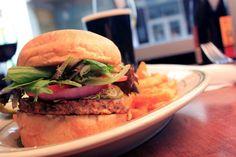 Black Bean Burger - black bean vegetarian burger, cheddar jack, guacamole, alfalfa sprouts, field greens, roma tomato, onion