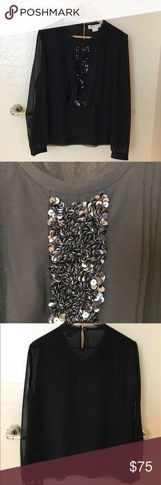Michael Kors black blouse Michael Kors black top with Sequins on center part of blouse. Blouse has frayed edges. Runs a bit smaller, narrow.  Only worn once. MICHAEL Michael Kors Tops Blouses